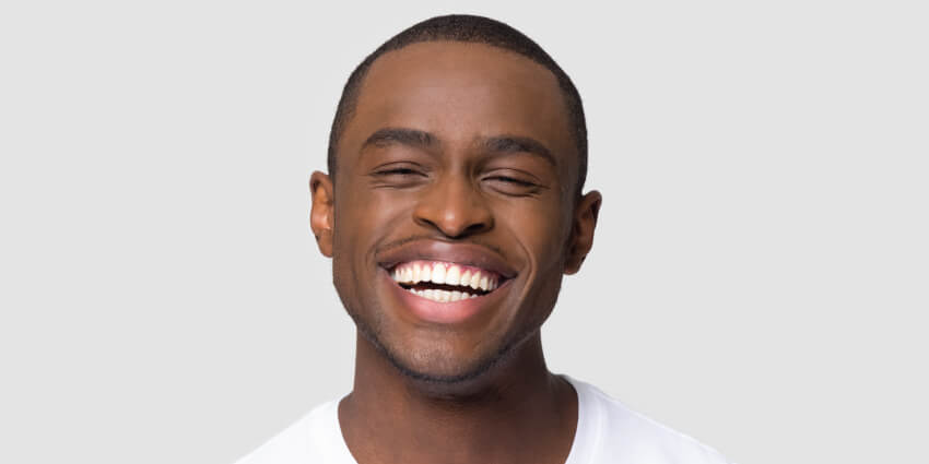 Man smiling after visiting dentist