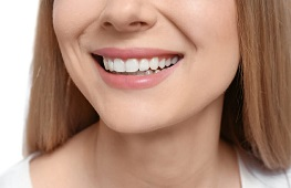 Closeup of woman smiling with white teeth